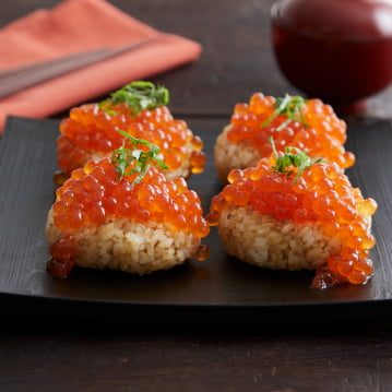 Roasted Rice Ball with Alaska Ikura Salmon Roe Spilling out